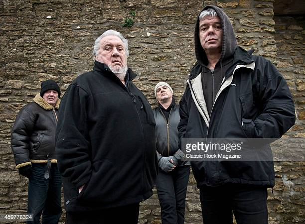 Dave Greenfield Jet Black Baz Warne and JeanJacques Burnel of English postpunk group The Stranglers photographed at their band headquarters in Frome...