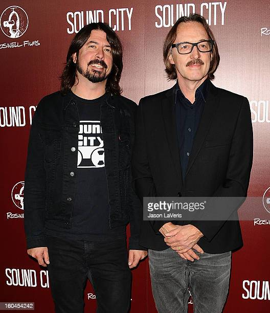 Dave Grohl and Butch Vig attend the premiere of Sound City at ArcLight Cinemas Cinerama Dome on January 31 2013 in Hollywood California