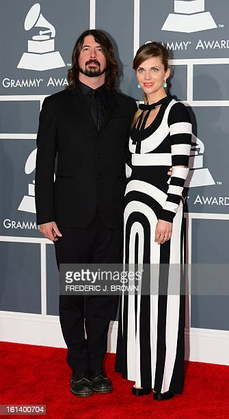 Dave Grohl and his wife Jordyn arrive on the red carpet at the Staples Center for the 55th Grammy Awards in Los Angeles California February 10 2013...