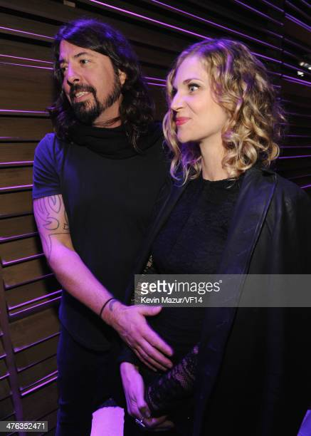 Dave Grohl and Jordyn Blum attend the 2014 Vanity Fair Oscar Party Hosted By Graydon Carter on March 2 2014 in West Hollywood California