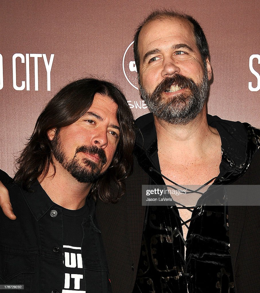 Dave Grohl and Krist Novoselic of Nirvana attend the premiere of 'Sound City' at ArcLight Cinemas Cinerama Dome on January 31, 2013 in Hollywood, California.