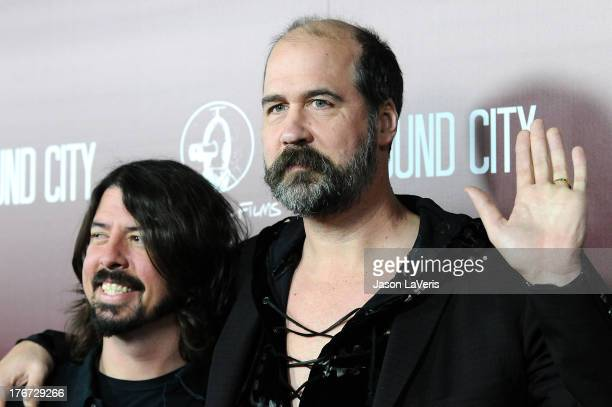 Dave Grohl and Krist Novoselic of Nirvana attend the premiere of Sound City at ArcLight Cinemas Cinerama Dome on January 31 2013 in Hollywood...