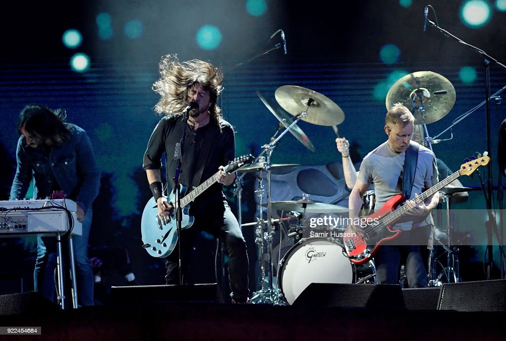 Dave Grohl (L) and Nate Mendel of Foo Fighters perform on stage at The BRIT Awards 2018 held at The O2 Arena on February 21, 2018 in London, England.