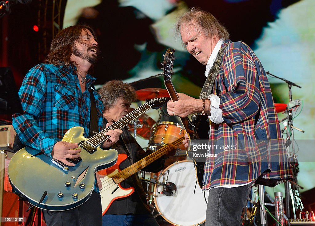 Dave Grohl and Neil Young perform onstage at the The Global Citizen Festival in Central Park to end extreme poverty - Show at Central Park on September 29, 2012 in New York City.