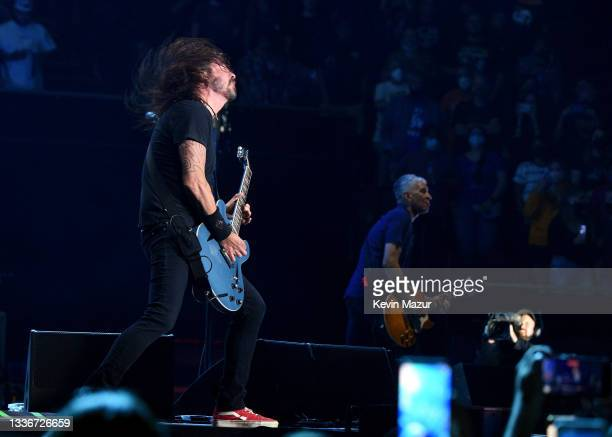 Dave Grohl and Pat Smear of Foo Fighters perform onstage at The Forum on August 26, 2021 in Inglewood, California.
