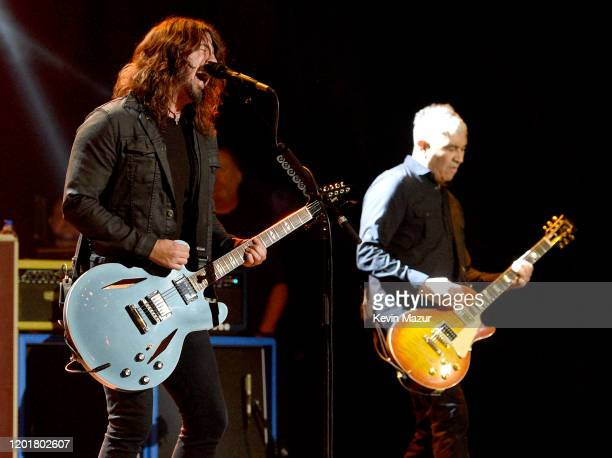 Dave Grohl and Pat Smear of music group Foo Fighters perform onstage during MusiCares Person of the Year honoring Aerosmith at West Hall at Los...