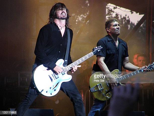Dave Grohl and Pat Smear of The Foo Fighters perform on stage at Milton Keynes Bowl on July 2nd, 2011 in Milton Keynes, United Kingdom.