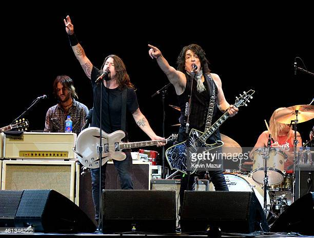 Dave Grohl and Paul Stanley perform onstage during Dave Grohl's birthday bash at The Forum on January 10 2015 in Inglewood California
