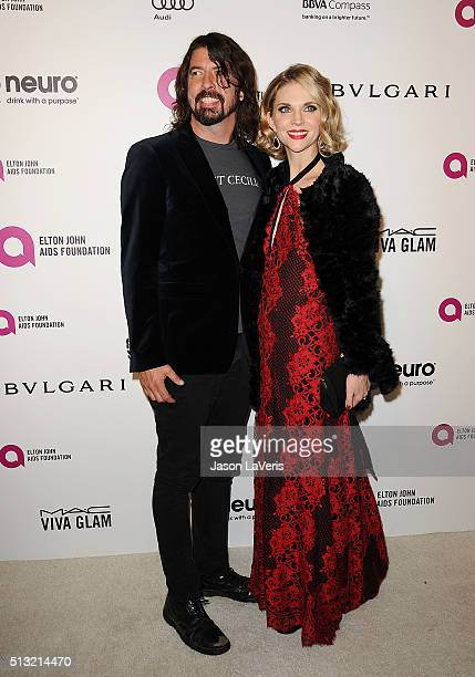 Dave Grohl and wife Jordyn Blum attend the 24th annual Elton John AIDS Foundation's Oscar viewing party on February 28 2016 in West Hollywood...