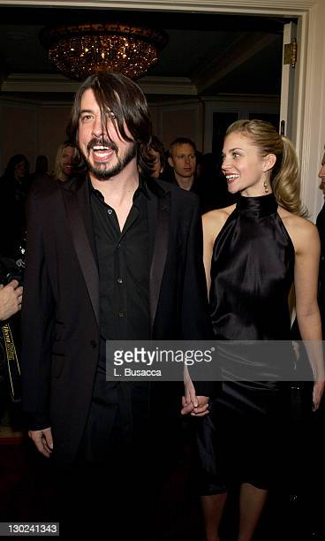 Dave Grohl and wife Jordyn Blum during 2004 Clive Davis PreGrammy Party – Inside Arrivals at Beverly Hills Hotel in Beverly Hills California United...