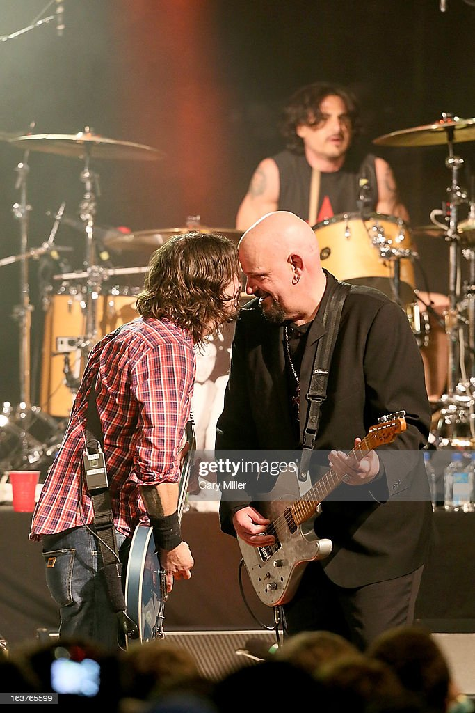 Dave Grohl, Chris Gros and Brad Wilk perform in concert at the Sound City showcase at Stubbs BBQ during the South By Southwest Music Festival on March 14, 2013 in Austin, Texas.