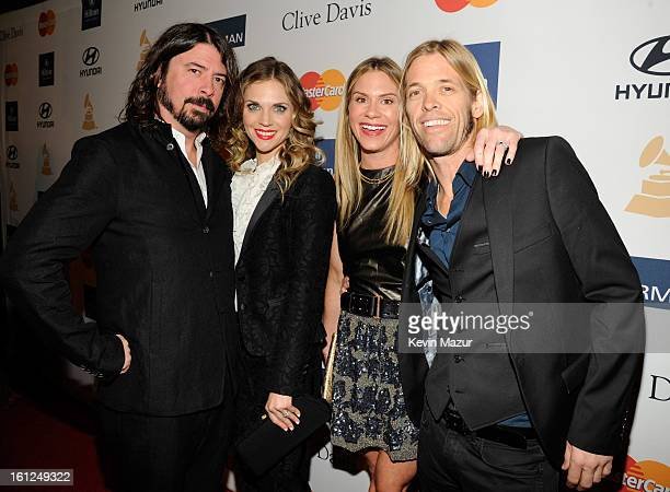 Dave Grohl Jordyn Blum Taylor Hawkins and Alison Hawkins arrive at the 55th Annual GRAMMY Awards PreGRAMMY Gala and Salute to Industry Icons honoring...