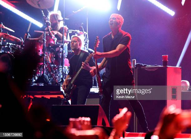 Dave Grohl, Nate Mendel, and Pat Smear of Foo Fighters perform onstage at The Forum on August 26, 2021 in Inglewood, California.