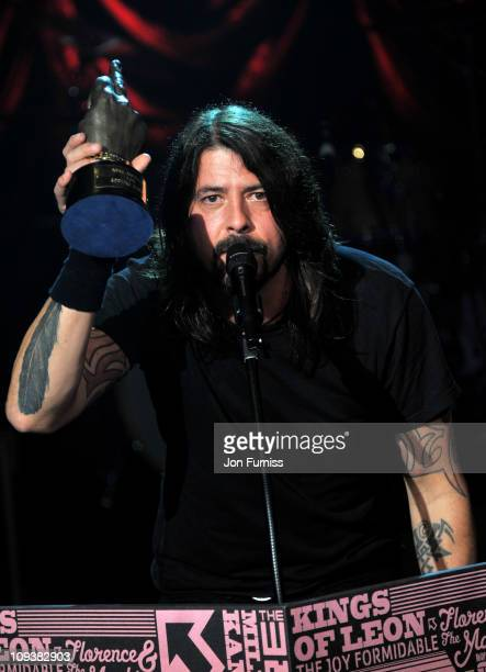 Dave Grohl of Foo Fighters excepts the award for 'Godlike Genius' during the NME Awards 2011 at Brixton Academy on February 23 2011 in London England