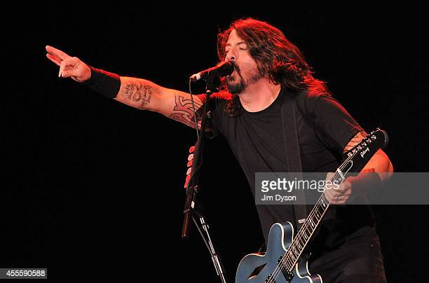 Dave Grohl of Foo Fighters performs live on stage at the Invictus Games Closing Concert at Queen Elizabeth Olympic Park on September 14 2014 in...