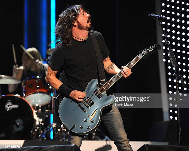Dave Grohl of Foo Fighters performs on stage at The 2012 MusiCares Person Of The Year Gala Honoring Paul McCartney at Los Angeles Convention Center...