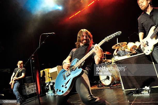 Dave Grohl of Foo Fighters performs on stage at the Gloria Theatre on February 28 2011 in Cologne Germany