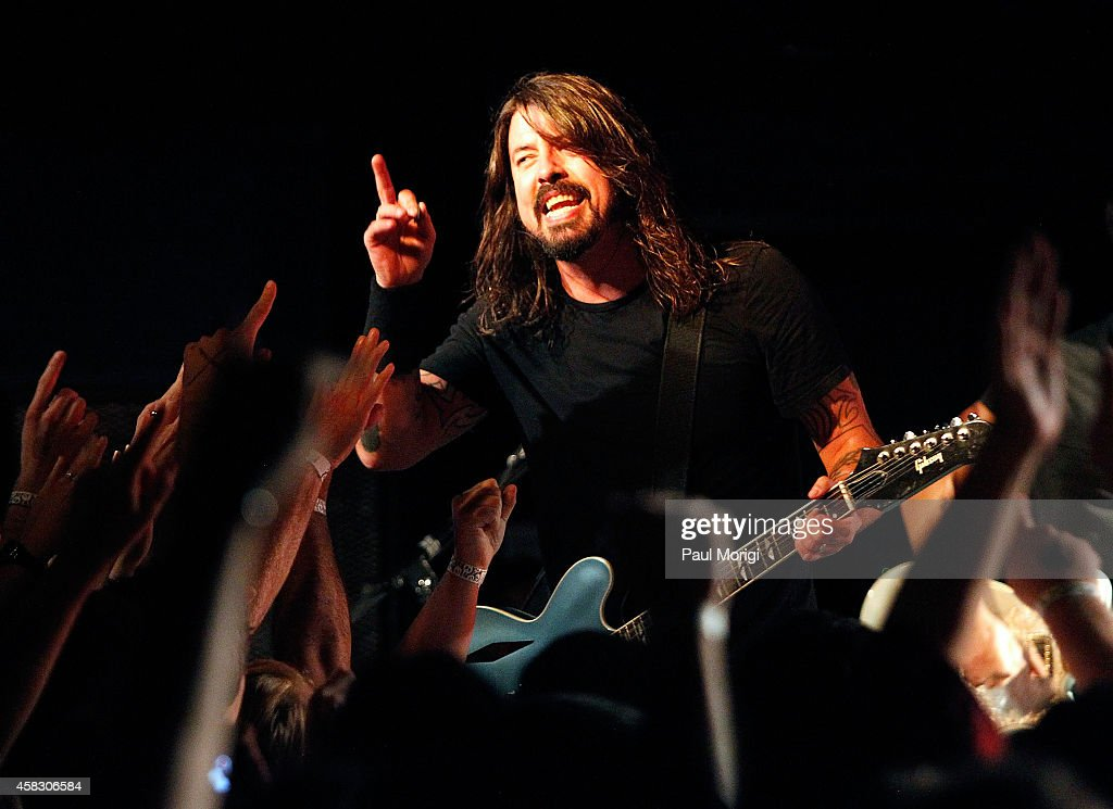 Dave Grohl of the Foo Fighters performs in concert after the 'Foo Fighters: Sonic Highways' screening at the Black Cat on October 24, 2014 in Washington, DC.