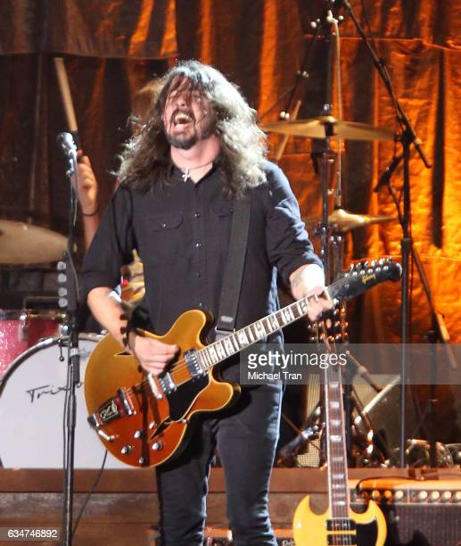 Dave Grohl of The Foo Fighters performs onstage during the 2017 MusiCares Person of the Year honors Tom Petty held on February 10 2017 in Los Angeles...