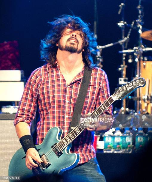 Dave Grohl of the Foo Fighters performs with the Sound City Players at Stubb's Outdoor Arena on March 14 2013 in Austin Texas