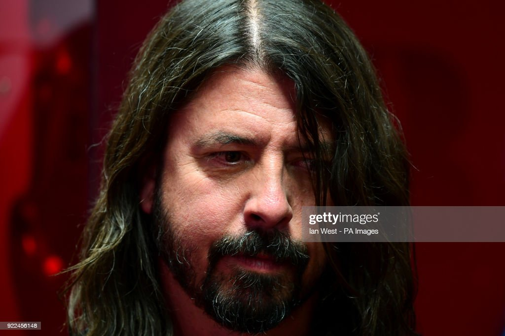 Dave Grohl of the Foo Fighters with their award for Best International Group in the press room during the Brit Awards at the O2 Arena, London.