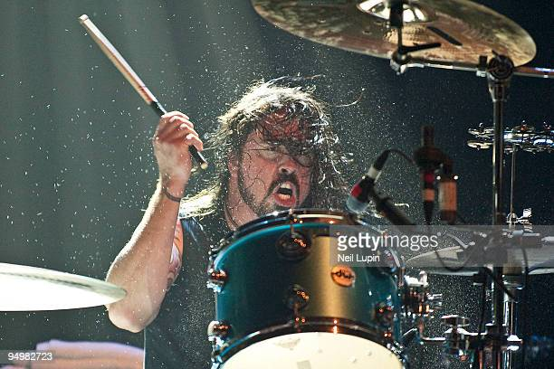 Dave Grohl of Them Crooked Vultures performs on stage playing drums at Hammersmith Apollo on December 17 2009 in London England