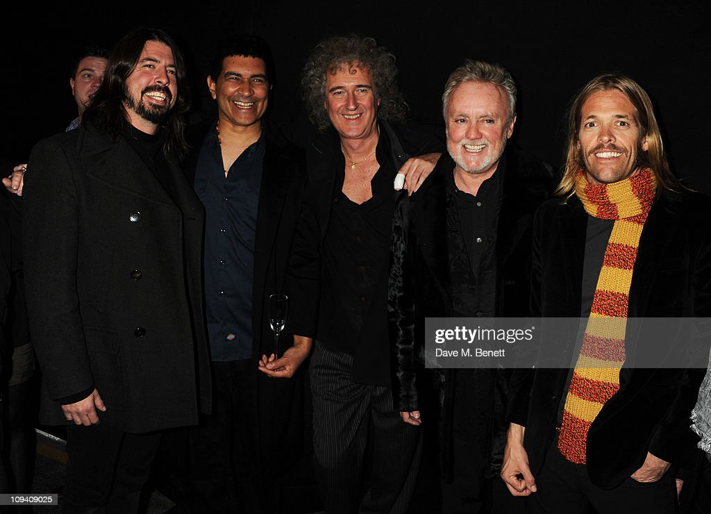 Dave Grohl, Pat Smear, Brian May, Roger Taylor and Taylor Hawkins attend the private view of 'Stormtroopers In Stilettos' an exhibition celebrating 40 years of the band Queen at The Old Truman Brewery on February 24, 2011 in London, England.