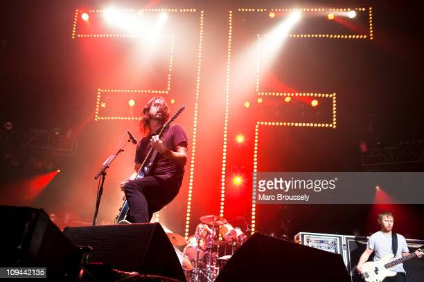 Dave Grohl Taylor Hawkins and Nate Mendel of Foo Fighters perform on stage during NME Awards Big Gig at Wembley Arena on February 25 2011 in London...