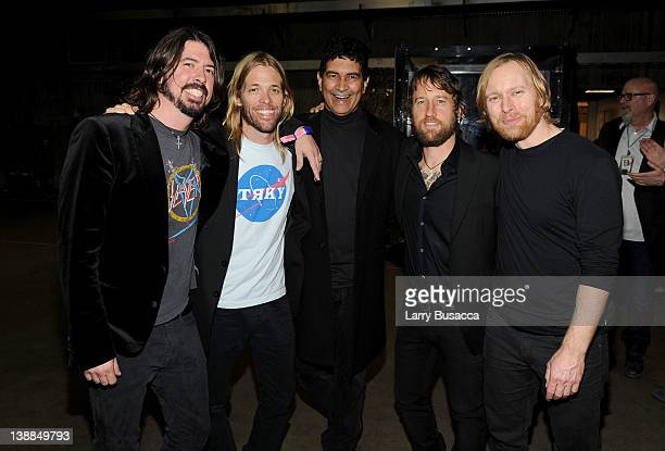 Dave Grohl, Taylor Hawkins, Pat Smear, Chris Shiflett and Nate Mendel of The Foo Fighters backstage at the 54th Annual GRAMMY Awards held at Staples...