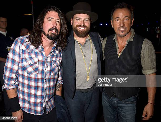 Dave Grohl Zac Brown and Bruce Springsteen pose backstage at 'The Concert For Valor' at The National Mall on November 11 2014 in Washington DC
