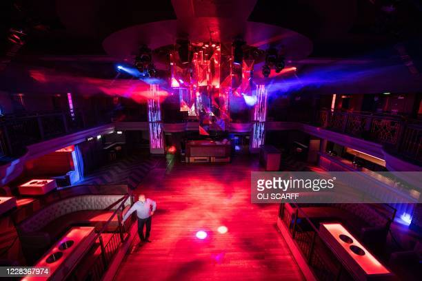 Dave Harrison, a Regional Director for the Deltic Group, poses for a photograph in the Nottingham PRYZM nightclub in Nottingham, central England on...