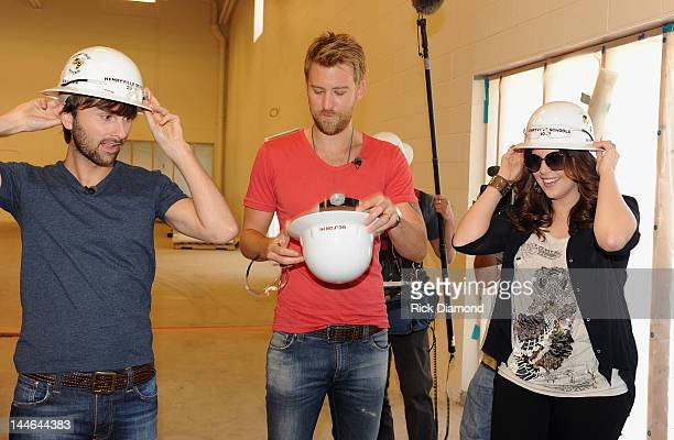 Dave Haywood Charles Kelley and Hillary Scott of Lady Antebellum during their visit of Henryville High School on May 16 2012 in Henryville Indiana