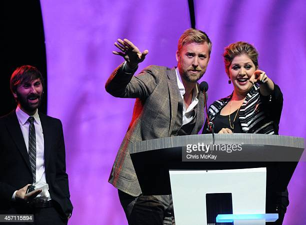 Dave Haywood Charles Kelly and Hillary Scott of Lady Antebellum accept their induction into the 36th annual Georgia Music Hall of Fame at the Georgia...