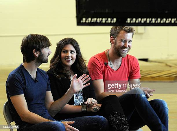 Dave Haywood Hillary Scott and Charles Kelley of Lady Antebellum interview with ABC during their visit of Henryville High School on May 16 2012 in...