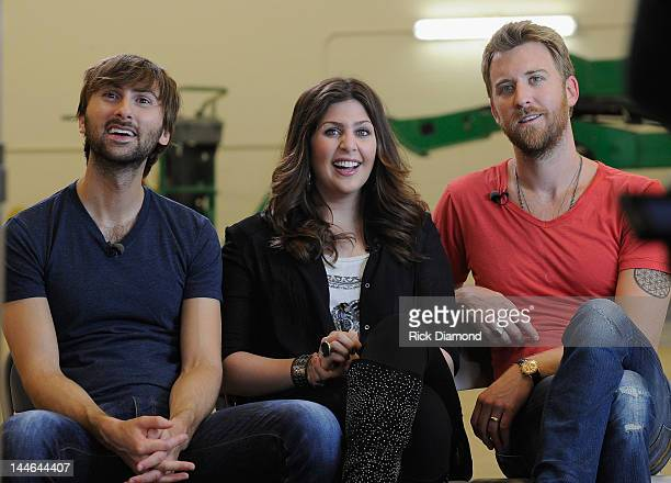 Dave Haywood Hillary Scott and Charles Kelley of Lady Antebellum during interview with ABC during their visit of Henryville High School on May 16...