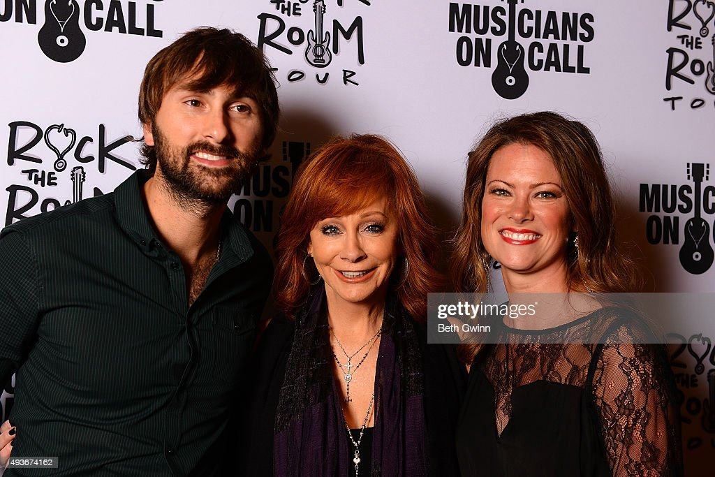 Dave Haywood, Reba McEntire, and Kelli Cashiola on the red carpet before the Musicians on Call event at City Winery Nashville on October 21, 2015 in Nashville, Tennessee.