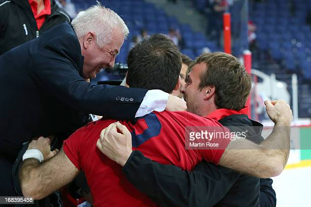 Dave Henderson , head coach of France celebrates after the IIHF World Championship group H match between Russia and France at Hartwall Areena on May...