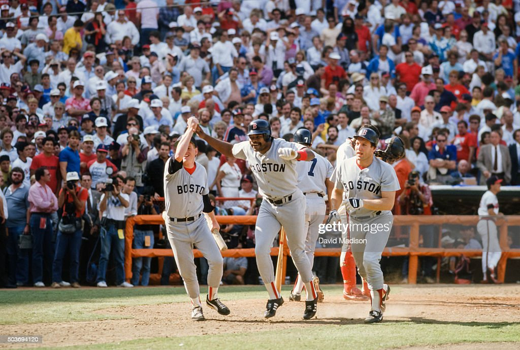 Dave Henderson of the Boston Red Sox celebrates after hitting a home run in the ninth inning of Game 5 of the 1986 ALCS against the California Angels on October 12, 1986 at Anaheim Stadium in Anaheim, California.