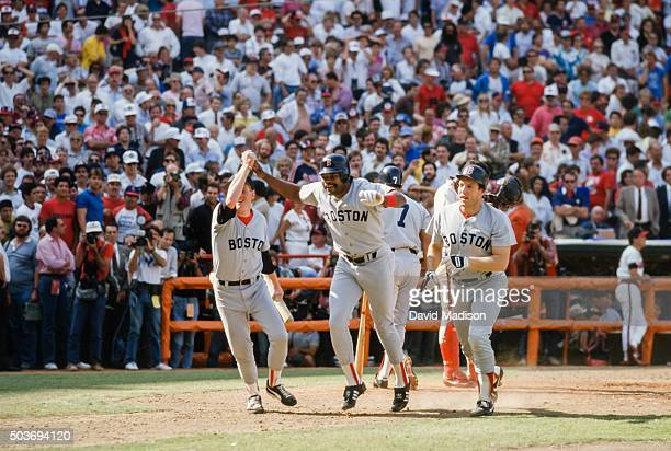 Dave Henderson of the Boston Red Sox celebrates after hitting a home run in the ninth inning of Game 5 of the 1986 ALCS against the California Angels...