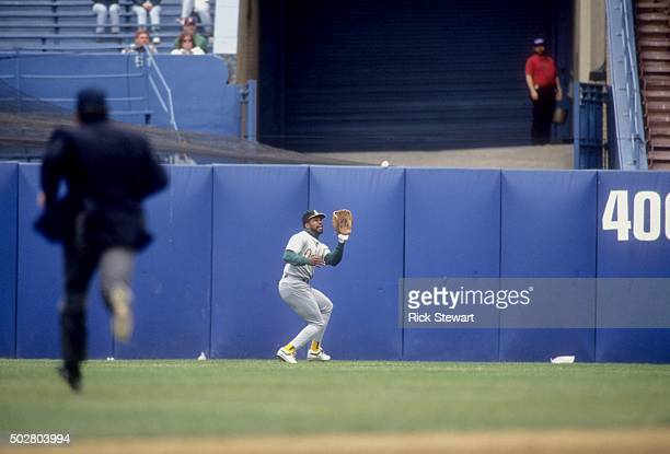 Dave Henderson of the Oakland Athletics catches a fly ball during an MLB game against the Cleveland Indians in May 1991 at Cleveland Municipal...