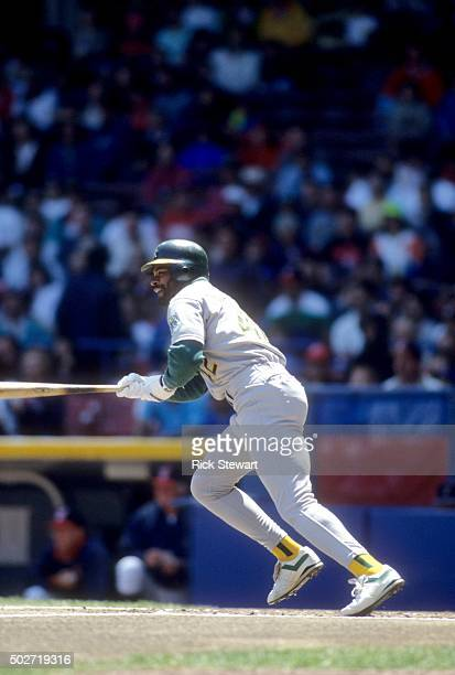 Dave Henderson of the Oakland Athletics runs to first base during an MLB game against the Cleveland Indians in May 1991 at the Cleveland Municipal...
