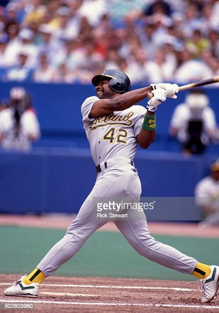 Dave Henderson of the Oakland Athletics swings during an MLB game against the Toronto Blue Jays circa 1990 at the Toronto Skydome in Toronto Ontario...