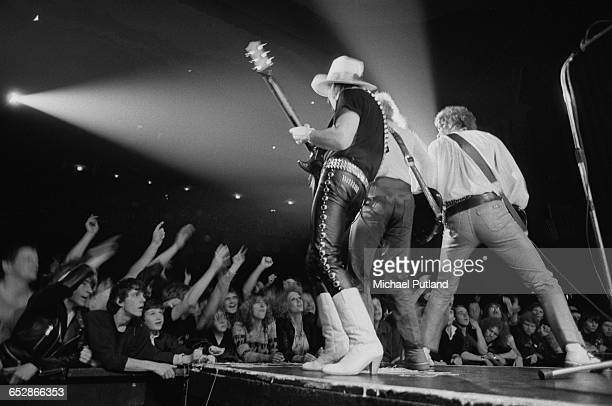 Dave Hill performing with Noddy Holder and Jim Lea of British rock group Slade 1981