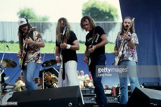 Dave Hlubek Duane Rowland Steve Holland and Banner Thomas performing with 'Molly Hatchet' at The Oakland Coliseum in Oakland California on May 271989