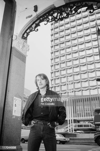 Dave Holland, British drummer with heavy metal band Judas Priest, poses beneath outside the Astoria on Charing Cross Road, opposite the Centrepoint...