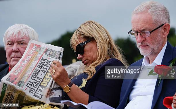 Dave Hopper Secretary of the Durham Miner's Association sits on the main stage with his wife Maritza and Labour Leader Jeremy Corbyn as he attends...
