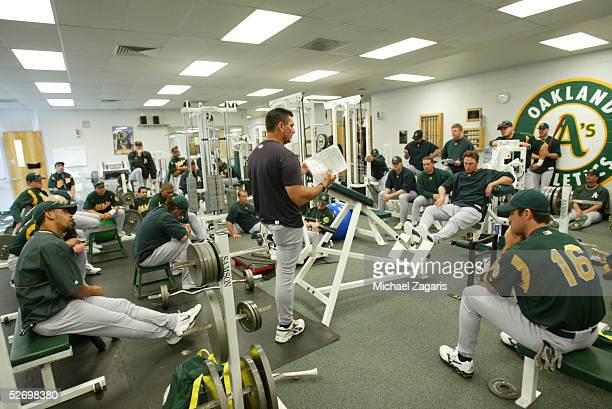 Dave Hudgens of the Oakland Athletics leads a hitters meeting in the clubhouse at Phoenix Municipal Stadium on February 24 2005 in Phoenix Arizona