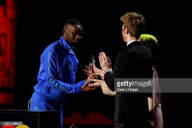 Dave is presented Mastercard Album of the Year by Billie Eilish and Finneas O'Connell at The BRIT Awards 2020 at The O2 Arena on February 18 2020 in...