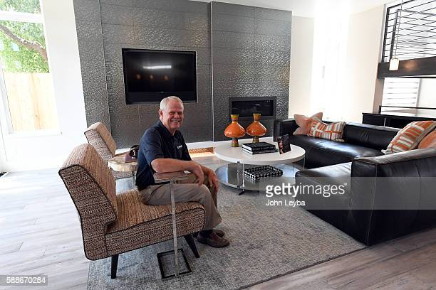 Dave Jackson Jackson design build sit in the living room of a house he designed and built The story is about how unusual it is to have a Dream Home...