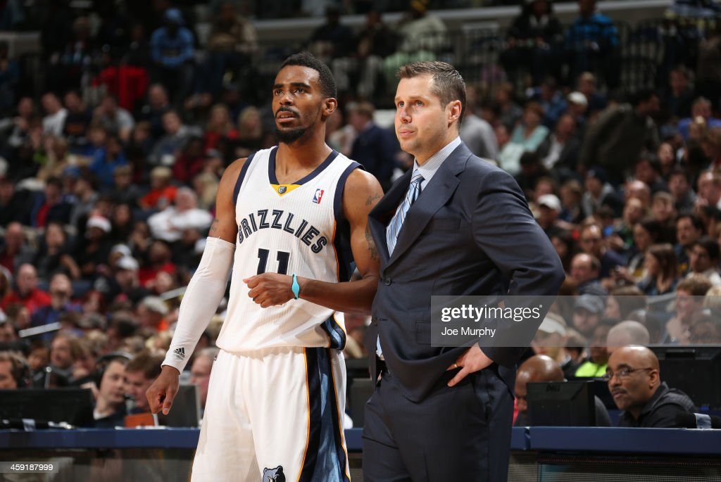 Dave Joerger head coach of the Memphis Grizzlies talks with MIke Conley #11 of the Memphis Grizzlies during a game against the Utah Jazz on December 23, 2013 at FedExForum in Memphis, Tennessee.